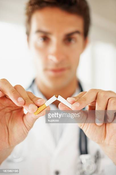 Medical practitioner breaking a cigarette