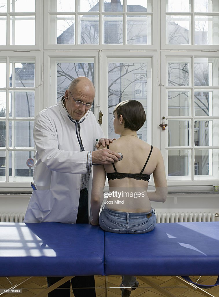 medical practitioner examing woman  : Stock Photo