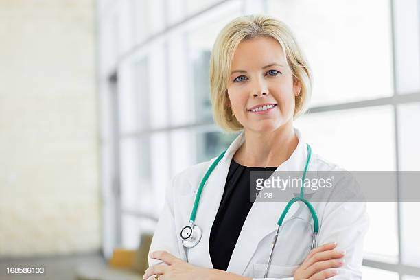 Medical practitioner looking at camera