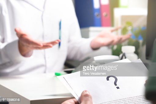 Medical problem. Patient reading health care document with question mark. New or unknown disease. Can't find or no cure for illness. Wrong diagnosis. : Stock Photo