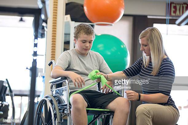 Medical professional showing preteen patient a new exercise