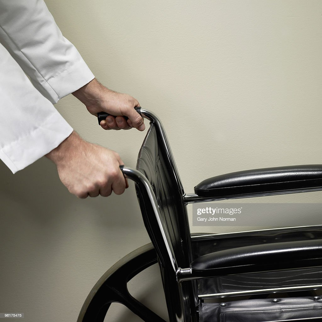 Medical proffesional pushing wheel chair