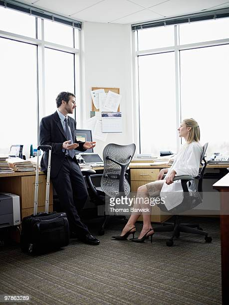 Medical sales representative with doctor in office