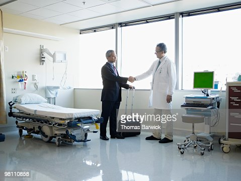 Medical sales representative with doctor : Stock Photo