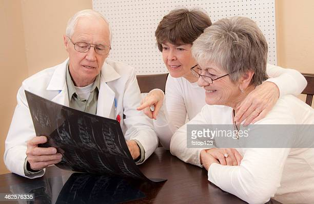 Medical: Senior patient and family member visit with doctor.
