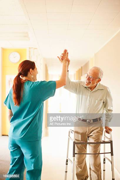 Medical staff and patient high five