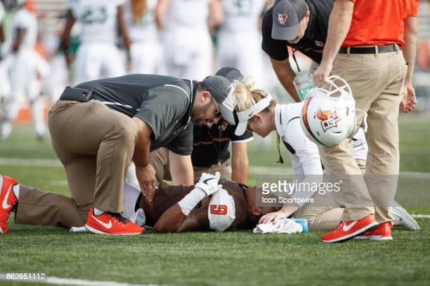 Medical staff attend to injured player Bowling Green Falcons wide receiver Teo Redding in the first half of a game between the Ohio Bobcats and the...