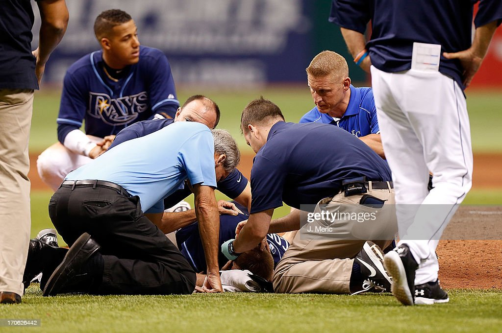 Medical staff attend to pitcher <a gi-track='captionPersonalityLinkClicked' href=/galleries/search?phrase=Alex+Cobb&family=editorial&specificpeople=7512114 ng-click='$event.stopPropagation()'>Alex Cobb</a> #53 of the Tampa Bay Rays after he was hit by a line drive against the Kansas City Royals during the game at Tropicana Field on June 15, 2013 in St. Petersburg, Florida.