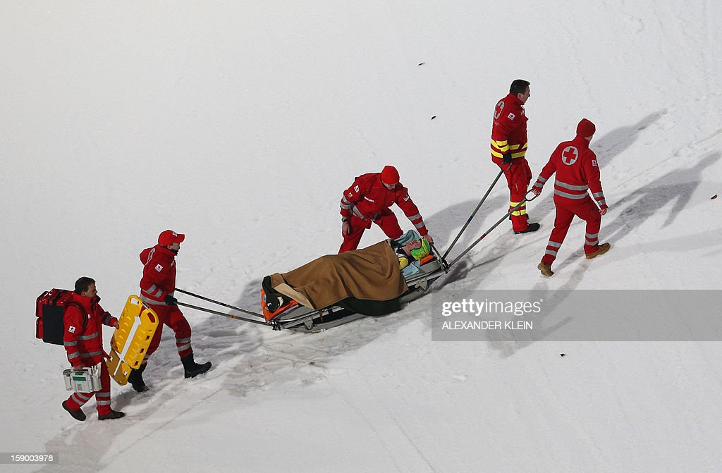 Medical staff evacuates Russia's Denis Kornilov during a practice session as part of the 61st edition of the FIS World Cup Four-Hills-Tournament (Vierschanzentournee) held in Bischofshofen on January 5, 2013.