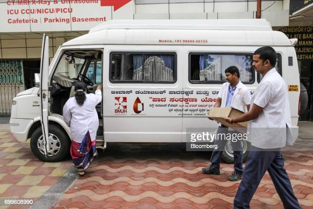 Medical staff from the Jain Institute of Vascular Sciences carry medical equipment to a vehicle at the Bhagwan Mahaveer Jain Hospital in Bengaluru...