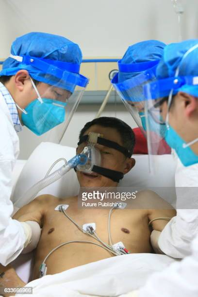 Medical staff help a patient infected by H7N9 bird flu on February 03 2017 in Sichuan province Suining China The health authority confirmed its first...