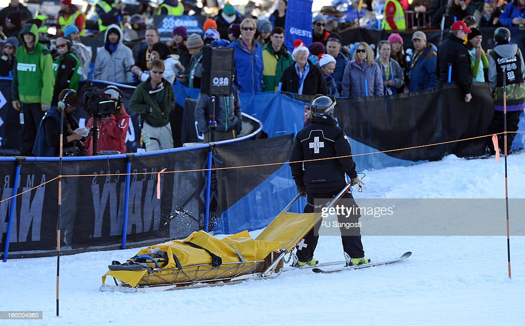 Medical staff takes Ashley Battersby down the mountain after she crashed during the Ski Slopestyle Women's Final, January 27, 2013. The 2013 Winter X Games at Buttermilk Mountain in Aspen.