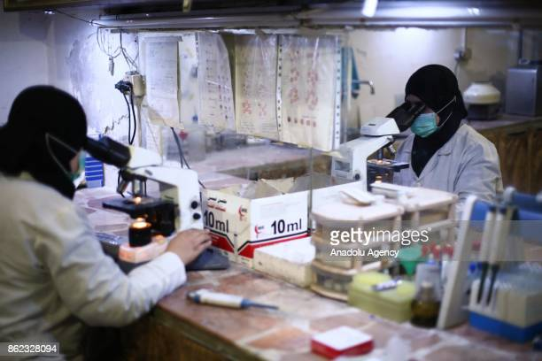 A medical staff using microscope in the laborator at AlRahmat Center which was found in 2013 and serves for the cancer patients in Eastern Ghouta of...