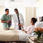 Medical staff visit patient