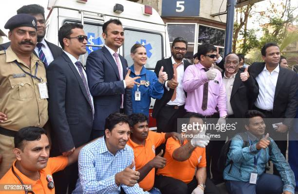 Medical staffs pose for picture near the ambulance which carries Eman Ahmed to the airport at Cargo Andheri on May 4 2017 in Mumbai India Eman Ahmed...