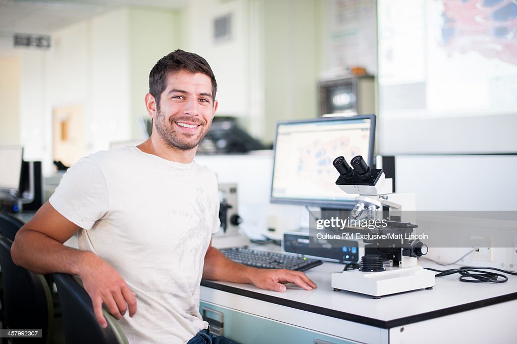 Medical student and microscope : Stock Photo