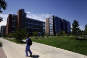A medical student walks on the University of Colorado Anschutz Medical Campus July 22 2012 in Aurora Colorado James Eagan Holmes who was a student at...