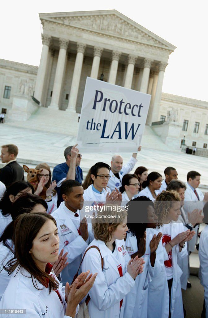 Medical students and professionals participate in a news conference in support of the Patient Protection and Affordable Care Act outside the U.S. Supreme Court Building on March 26, 2012 in Washington, DC. Today the high court, which has set aside six hours over three days, will hear arguments over the constitutionality of the act.