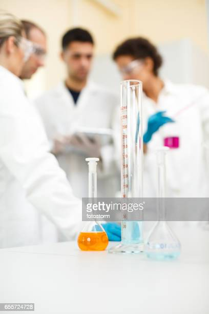 Medical students doing experiment in laboratory