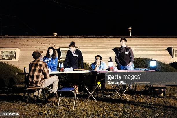 Medical students give a checkup to a Jamaican migrant worker on a H2A visa at a Connecticut apple orchard and farm on October 11 2017 in Middlefield...