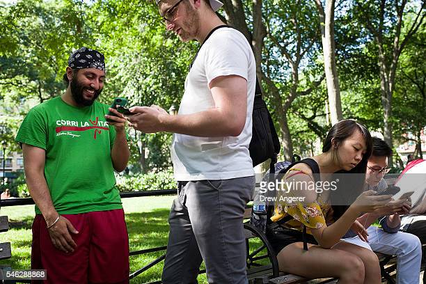 Medical students Jag Chilana and Scott Kobner play Pokemon Go on their smartphones at Union Square July 11 2016 in New York City The success of...