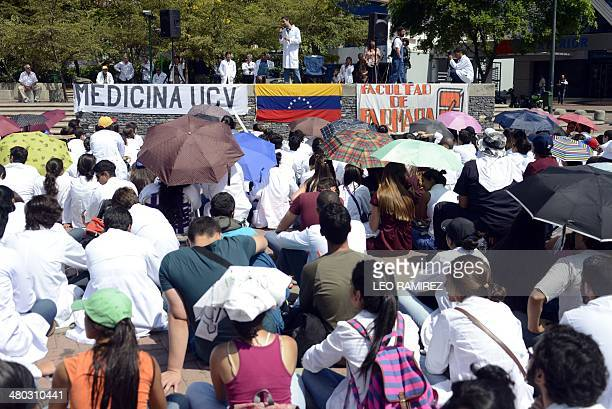 A medical teacher from the Venezuelan Central University gives an open air masterclass at a square as a protest for the lack of medical supplies in...