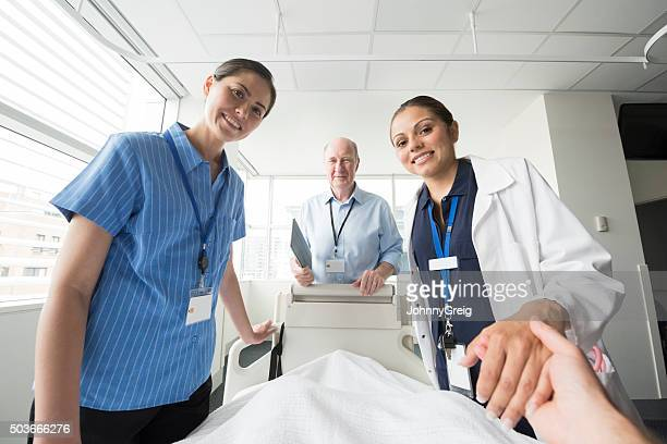Medical team at patient's bedside, personal point of view