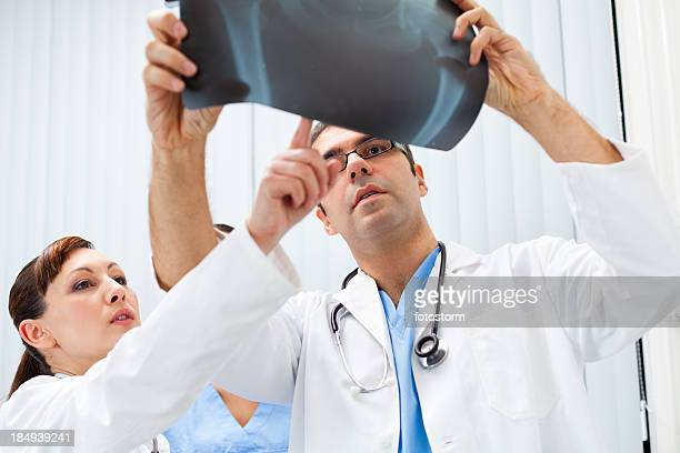 Medical team examining X-ray image