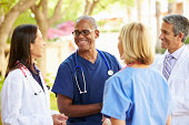 Medical Team Having Discussion Outdoors During Summer
