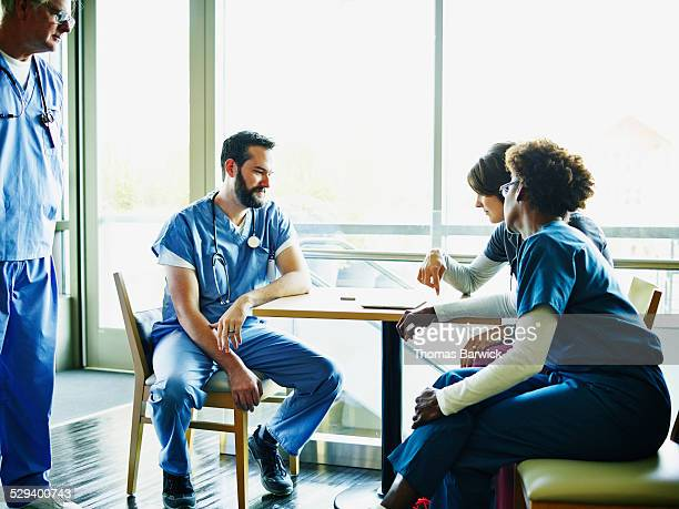Medical team in discussion in employee lounge