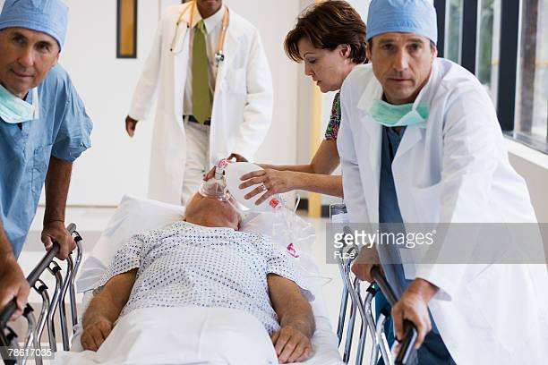 Medical Team Rushing Patient Through Hospital