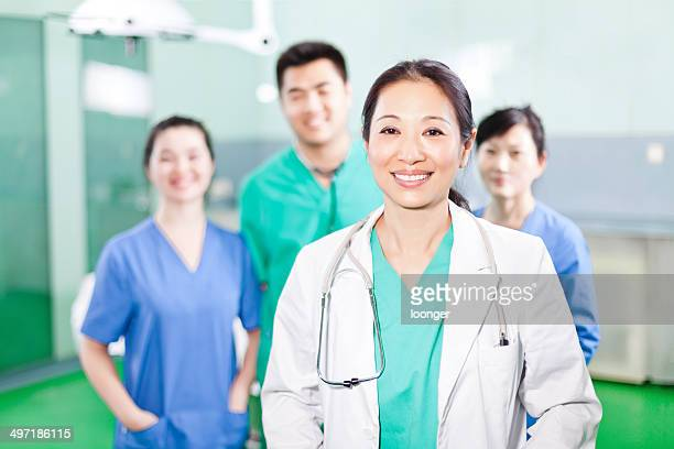Medical team standing in the operating room