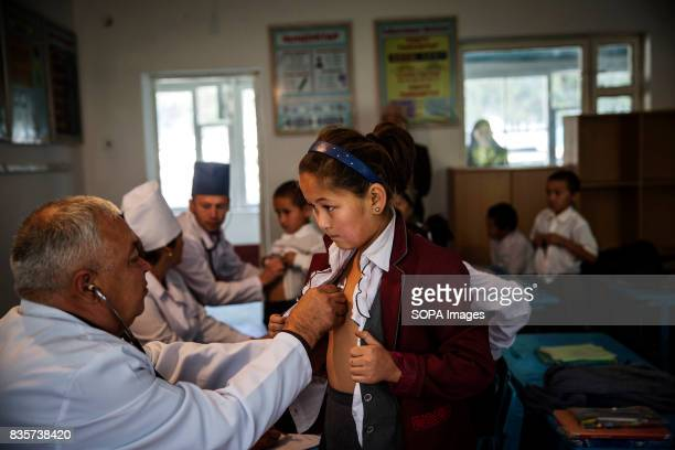 A medical team visit an elementary school in Beshkent Kyrgyzstan where nearly all villagers gather water from the aryk an irrigation canal or...