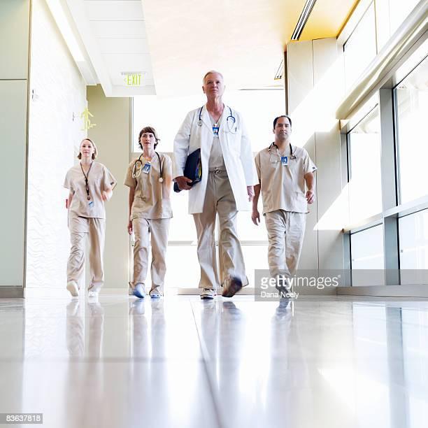 Medical team walking in hospital corridor