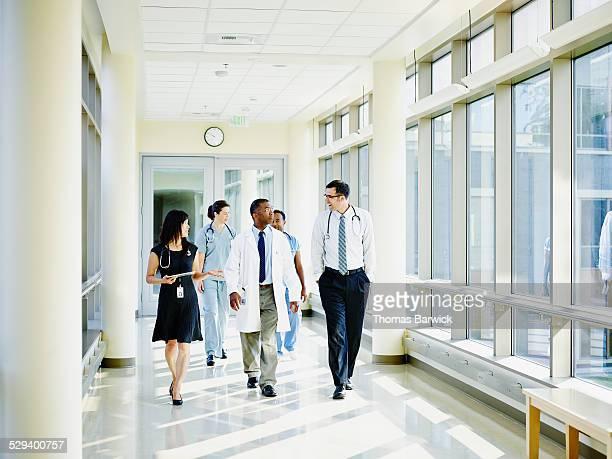 Medical team walking through hospital corridor