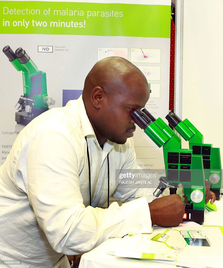 Medical Technologist and Customer Service Director of PARTEC Alex Lope demonstrates through a microscope the rapid detection of malaria and diagnosis during the 6th MIM Pan-African Malaria Conference held at the International Convention Centre in Durban on October 8, 2013.The theme of the conference is - Moving Towards Malaria Elimination:Investing in Research And Control.The conference ends on October 11, 2013.