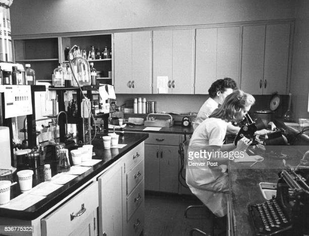 Medical Technologists Mrs Donald Skinner 9400 E Belle view Ave and Mrs E C Mitchell 17200 Parker Rd work in the crowded clinical laboratory The...