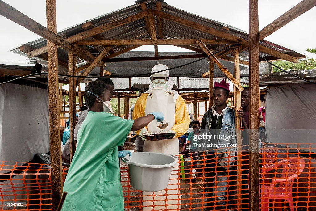 A medical worker collects food for Ebola patients at the Doctors Without Border treatment center in Kailahun Sierra Leone on Sunday August 17 2014...