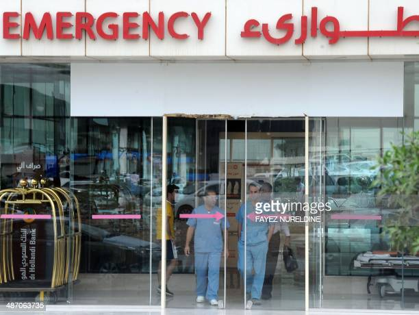 Medical workers leave the hospital's emergency department on April 27 2014 in the Saudi capital Riyadh The MERS death toll in Saudi Arabia neared 100...