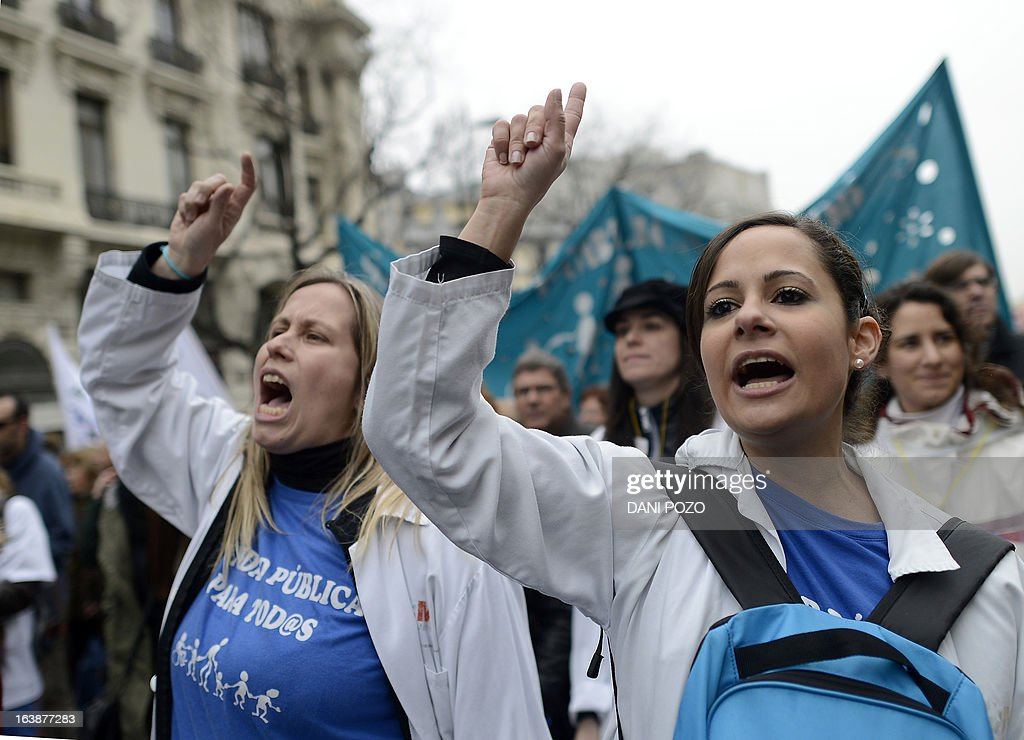Medical workers take part in a protest against government's austerity measures and health care spending cuts in Madrid on March 17, 2013.