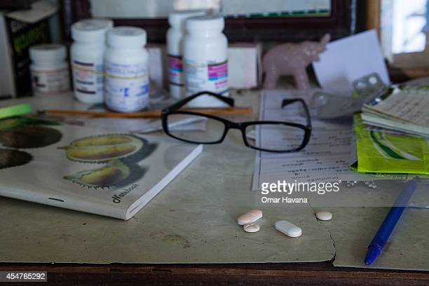 HIV medication is seen on a table inside one of the houses of the community on September 6 2014 in Tuol Sambo Cambodia Three different communities...