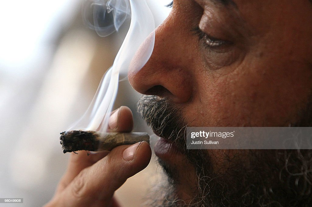 Medicinal marijuana user Dave Karp smokes marijuana at the Berkeley Patients Group March 25, 2010 in Berkeley, California. California Secretary of State Debra Bowen certified a ballot initiative late yesterday to legalize the possession and sale of marijuana in the State of California after proponents of the measure submitted over 690,000 signatures. The measure will appear on the November 2 general election ballot.