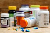 Medicine bottles and tablets on wooden deskMedicine bottles and tablets on wooden desk