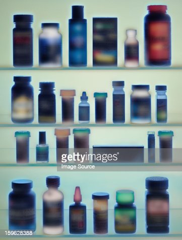 Medicine bottles in cabinet : Stock Photo
