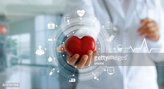 Medicine doctor holding red heart shape in hand and icon medical network connection with modern virtual screen interface, medical technology network concept : Stock Photo