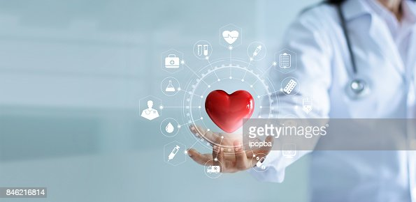 Medicine doctor holding red heart shape in hand with medical icon network connection modern virtual screen interface, service mind and medical technology network concept : Stock Photo