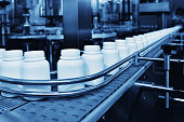 Close-up medicine filling in automated production line.