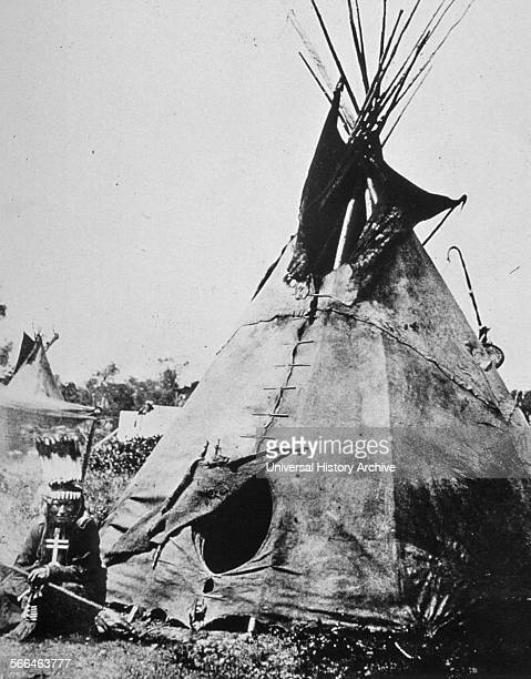 Medicine man outside his tepee Dated 1870