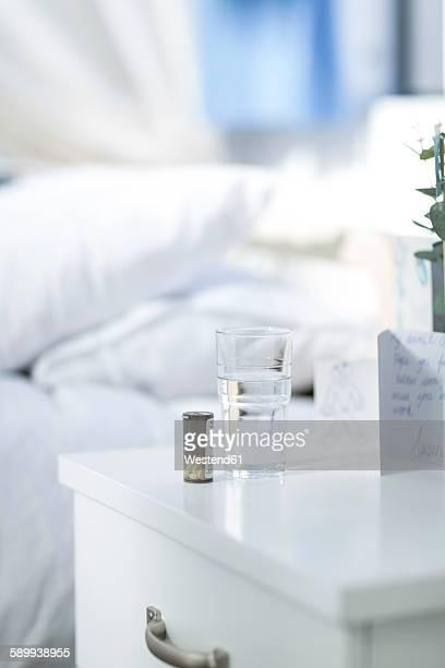 Medicine on hospital bedside table