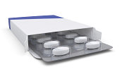 A medicine pills box. Isolated on a white background.Clipping Path to isolate the box and blister from the shadow is included.